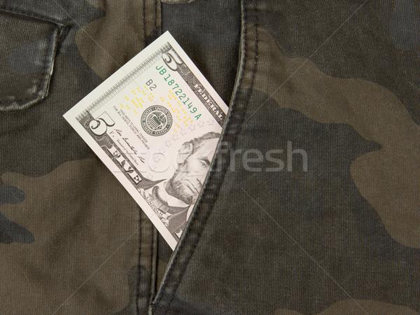 Macro shot of trendy jeans with american 5 dollar bill Stock photo © michaklootwijk