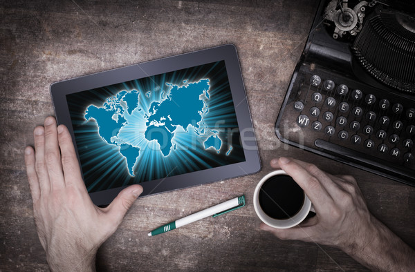World map on a tablet Stock photo © michaklootwijk