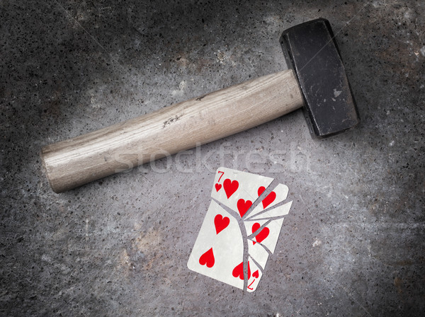 Hammer with a broken card, seven of hearts Stock photo © michaklootwijk