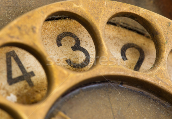 Close up of Vintage phone dial - 3 Stock photo © michaklootwijk