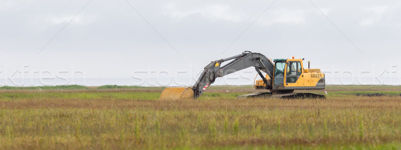 Yellow digger working Stock photo © michaklootwijk