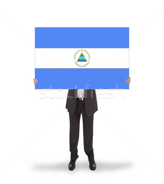 üzletember tart nagy kártya zászló Nicaragua Stock fotó © michaklootwijk
