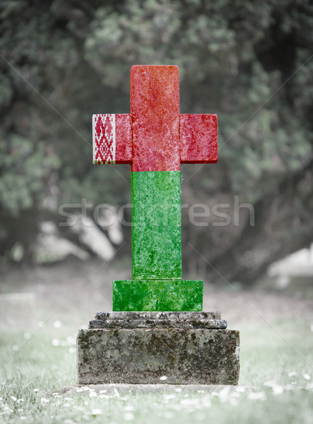 Grafsteen begraafplaats Wit-Rusland oude verweerde gras Stockfoto © michaklootwijk