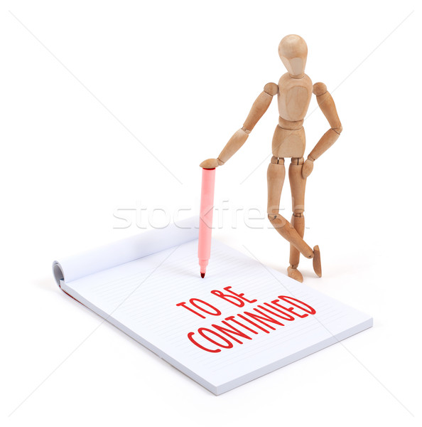 Wooden mannequin writing - To be continued Stock photo © michaklootwijk