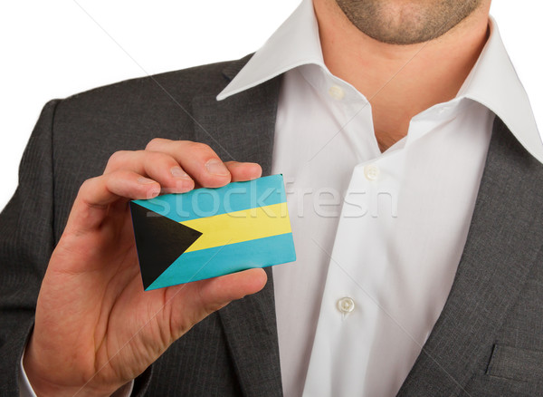 Businessman is holding a business card, The Bahamas Stock photo © michaklootwijk