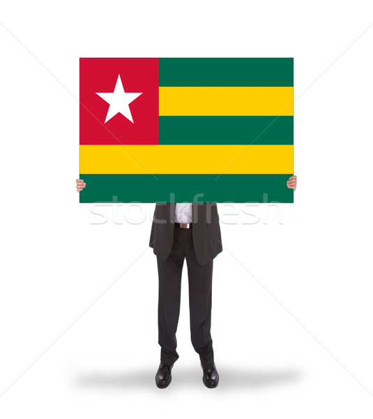 Businessman holding a big card, flag of Togo Stock photo © michaklootwijk