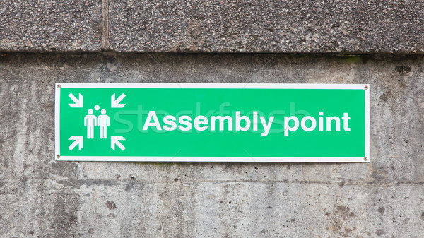 Green plastic 'assembly point' sign Stock photo © michaklootwijk