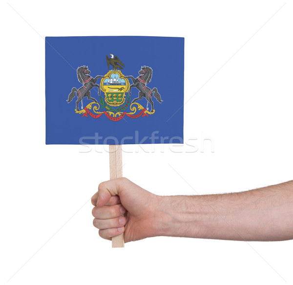 Hand holding small card - Flag of Pennsylvania Stock photo © michaklootwijk