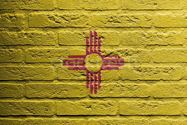Brick wall with a painting of a flag, New Mexico Stock photo © michaklootwijk
