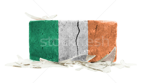 Baksteen gebroken glas geweld vlag Ierland muur Stockfoto © michaklootwijk