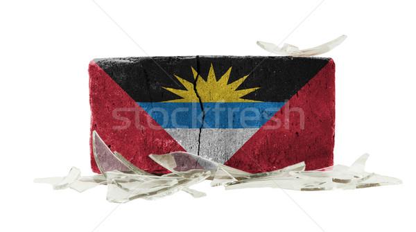 Mattone vetri rotti violenza bandiera muro vetro Foto d'archivio © michaklootwijk