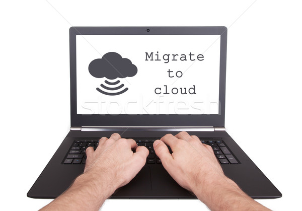 Man working on laptop, migrate to cloud Stock photo © michaklootwijk