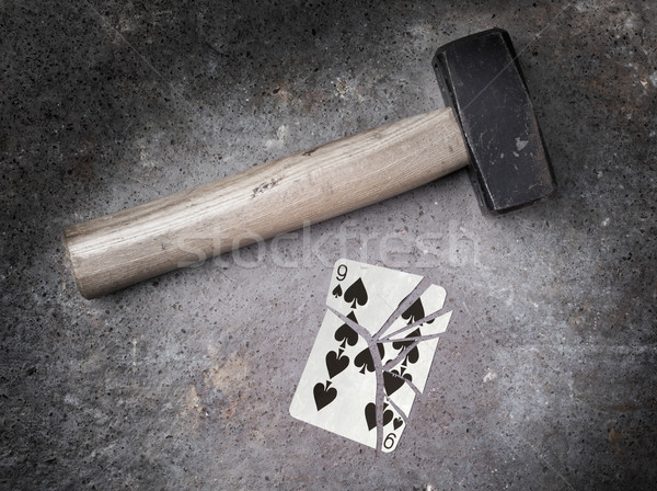 Hammer with a broken card, nine of spades Stock photo © michaklootwijk