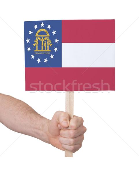 Kéz tart kicsi kártya zászló Grúzia Stock fotó © michaklootwijk
