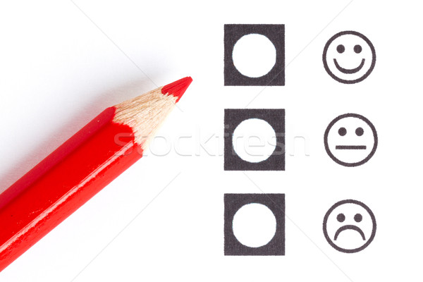 Red pencil choosing the right smiley Stock photo © michaklootwijk
