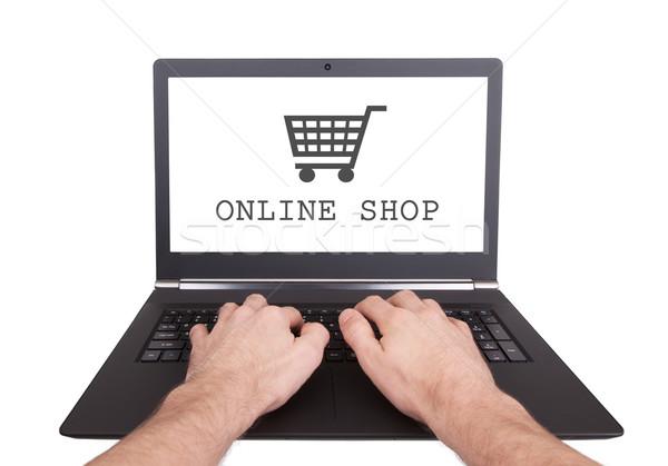 Man working on laptop, online shop Stock photo © michaklootwijk