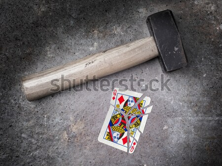 Hammer with a broken card, king of clubs Stock photo © michaklootwijk
