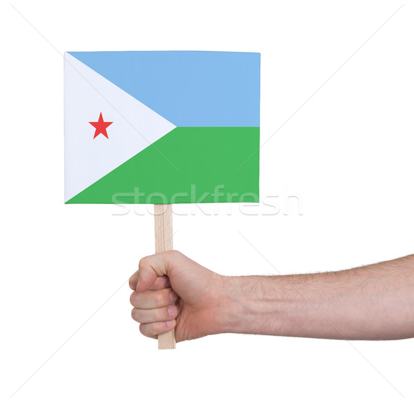 Hand holding small card - Flag of Djibouti Stock photo © michaklootwijk