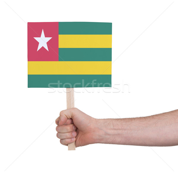 Hand holding small card - Flag of Togo Stock photo © michaklootwijk