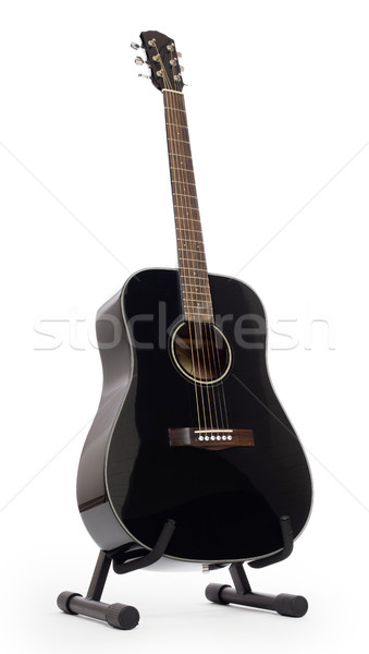 Black acoustic guitar on stand, isolated Stock photo © michaklootwijk