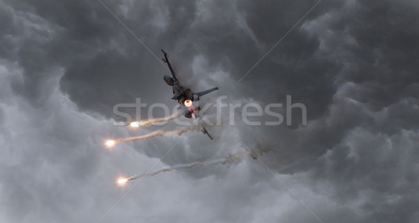 Military jet firing of flares Stock photo © michaklootwijk