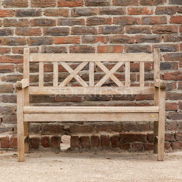 Rugged, primitive wooden sidewalk bench beside multi-colored ver Stock photo © michaklootwijk
