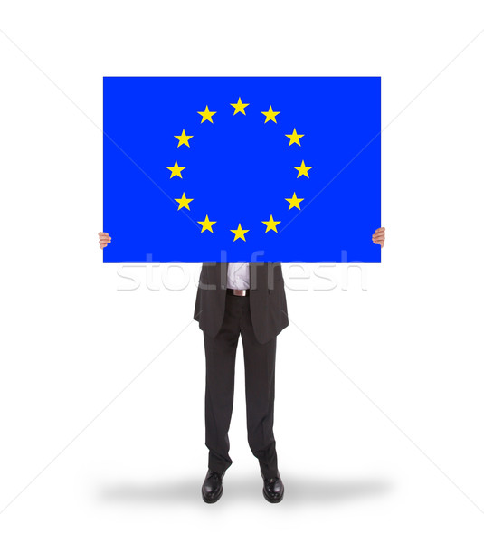 Smiling businessman holding a big card, flag of the European Uni Stock photo © michaklootwijk