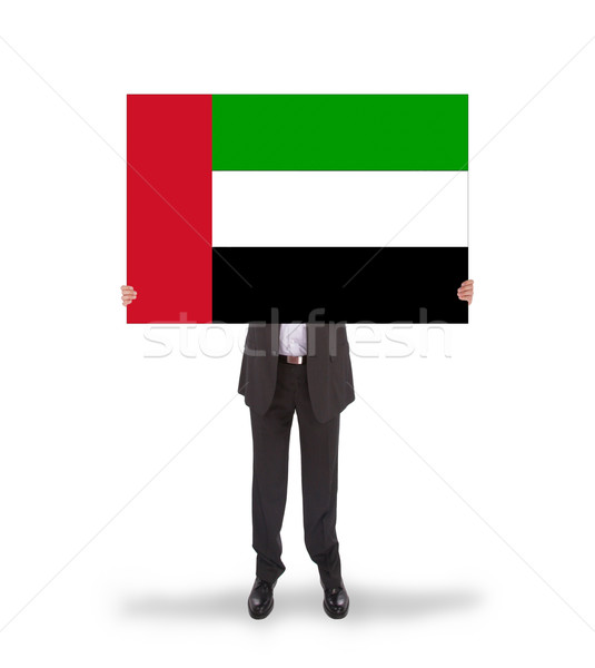 Businessman holding a big card, flag of the UAE Stock photo © michaklootwijk