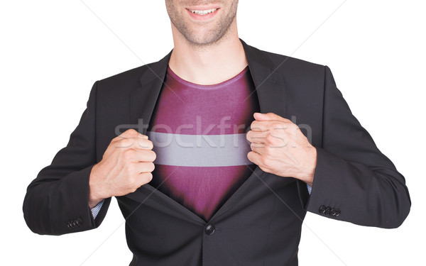 Empresario apertura traje camisa bandera Letonia Foto stock © michaklootwijk