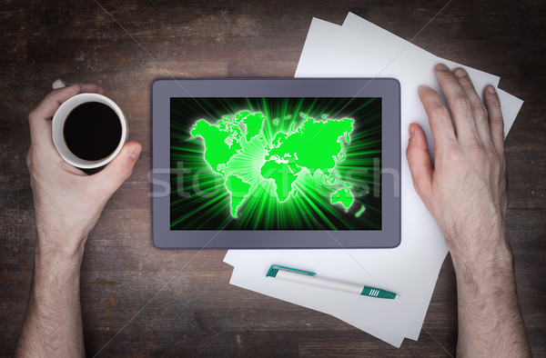 Мир карта таблетка бизнеса компьютер карта земле Сток-фото © michaklootwijk