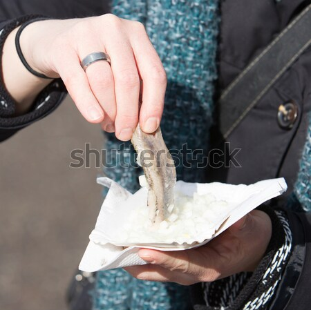 Dutch woman is eating typical raw herring Stock photo © michaklootwijk