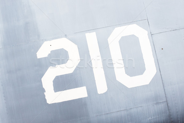 Painted number on an old war plane Stock photo © michaklootwijk