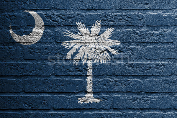 Brick wall with a painting of a flag, South Carolina Stock photo © michaklootwijk