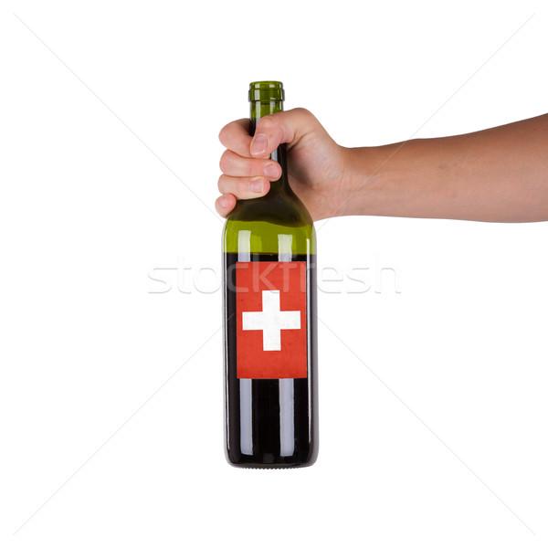 Mano botella vino tinto etiqueta Suiza Foto stock © michaklootwijk