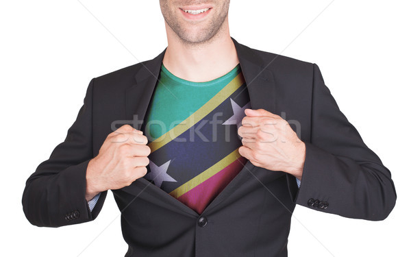 Businessman opening suit to reveal shirt with flag Stock photo © michaklootwijk