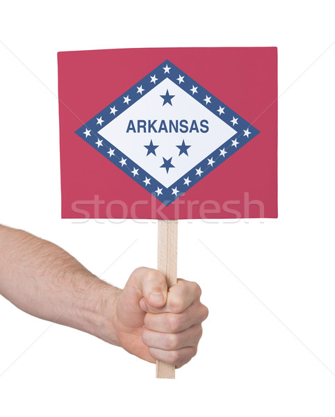 Kéz tart kicsi kártya zászló Arkansas Stock fotó © michaklootwijk