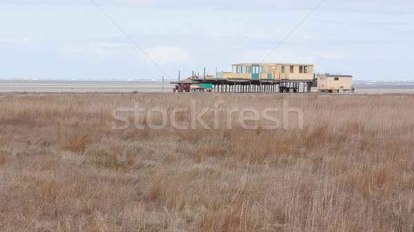 An old building on the dutch beach Stock photo © michaklootwijk