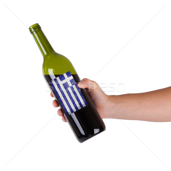 Mano botella vino tinto etiqueta Grecia Foto stock © michaklootwijk
