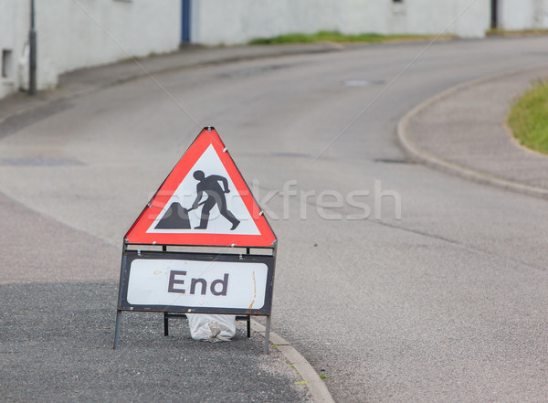Triangular construction sign standing on footpath Stock photo © michaklootwijk