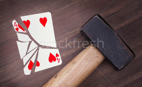Hammer with a broken card, four of hearts Stock photo © michaklootwijk