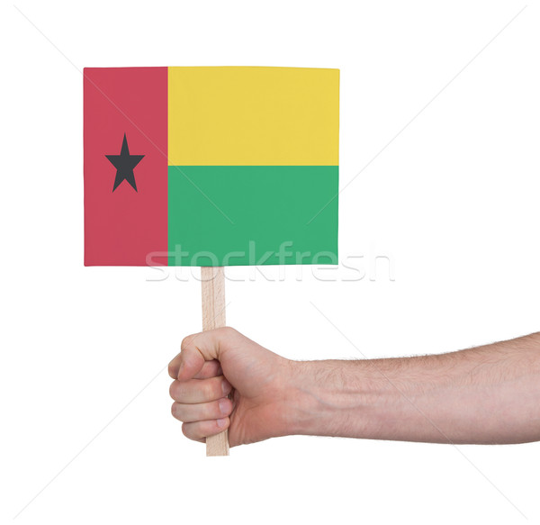 Hand holding small card - Flag of Guinea Bissau Stock photo © michaklootwijk
