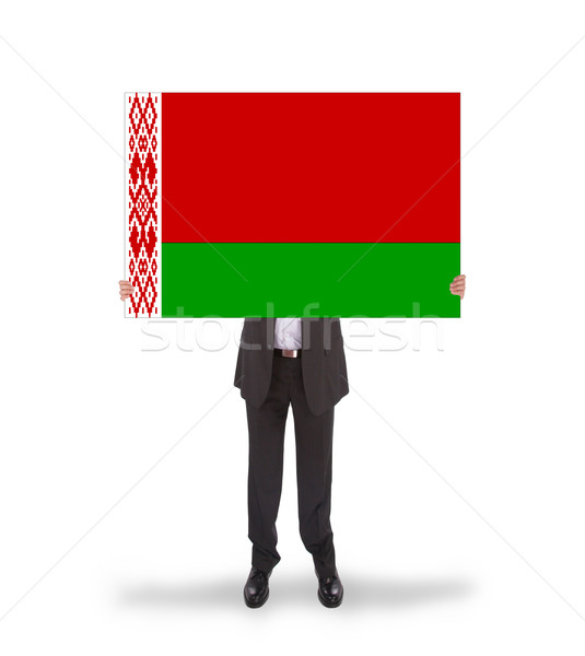 Businessman holding a big card, flag of Belarus Stock photo © michaklootwijk