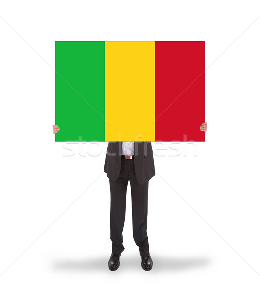 Businessman holding a big card, flag of Mali Stock photo © michaklootwijk