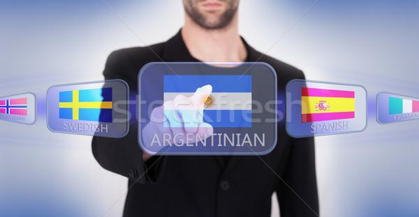 Main poussant écran tactile interface langue Photo stock © michaklootwijk