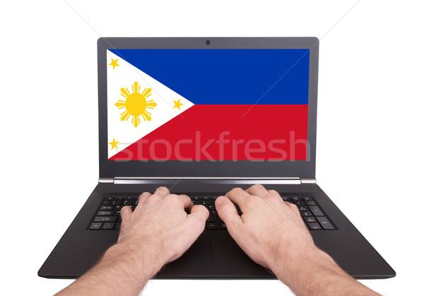 Hands working on laptop, Philippines Stock photo © michaklootwijk