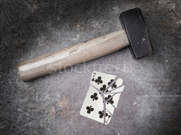 Hammer with a broken card, seven of clubs Stock photo © michaklootwijk