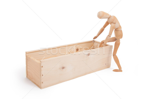 Wood figure mannequin stepping in a wooden box Stock photo © michaklootwijk