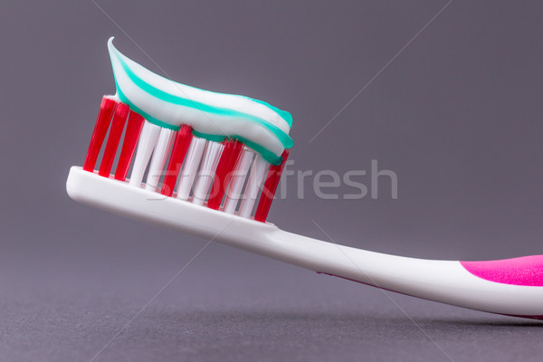 A pink toothbrush with toothpaste Stock photo © michaklootwijk