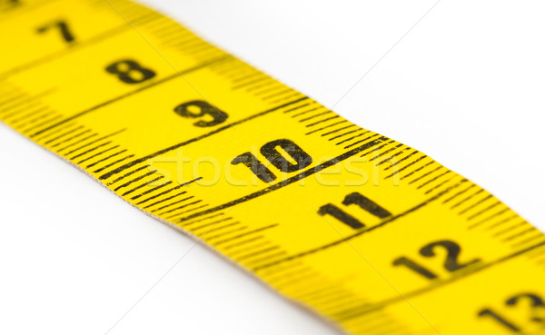 Yellow measuring tape isolated - selective focus Stock photo © michaklootwijk