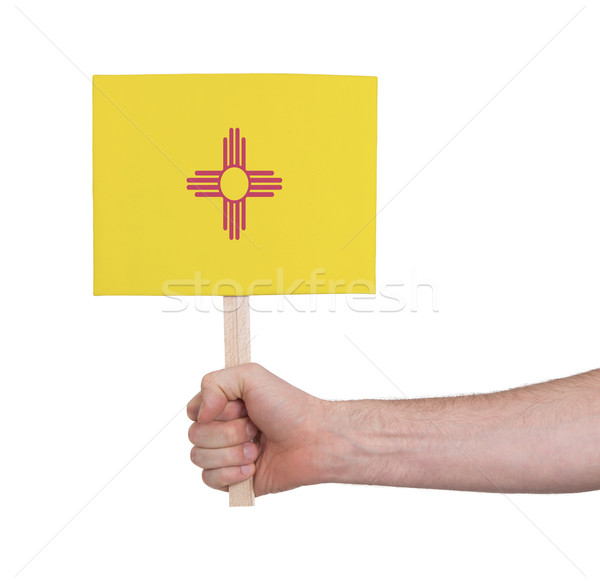 Hand holding small card - Flag of New Mexico Stock photo © michaklootwijk